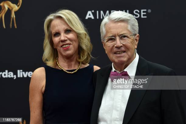 German radio and television presenter Frank Elstner and his wife Britta Gessler pose on the red carpet before the Bambi media prize ceremony on...