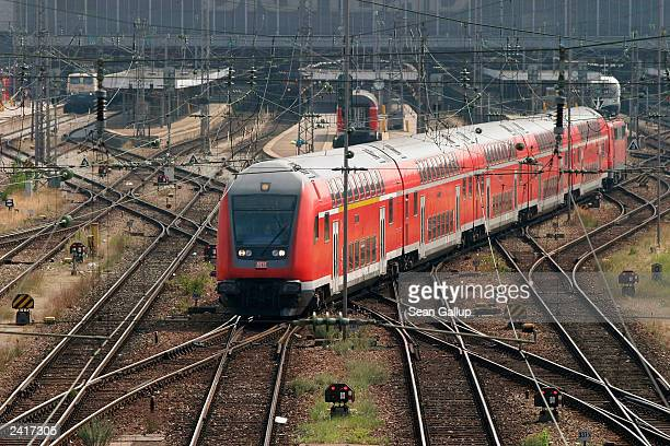 German Railways train leaves the main train station August 22 2003 in Munich Germany Deutsche Bahn announced mixed results August 21 2003 that...