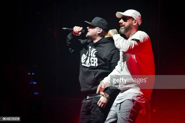 German rapper Kool Savas and Sido perform live on stage during a concert at the MaxSchmelingHalle on January 13 2018 in Berlin Germany