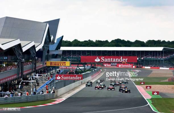German Red Bull Racing Formula One driver Sebastian Vettel driving his RB7 racing car ahead of his Australian teammate Mark Webber, Scuderia Ferrari...
