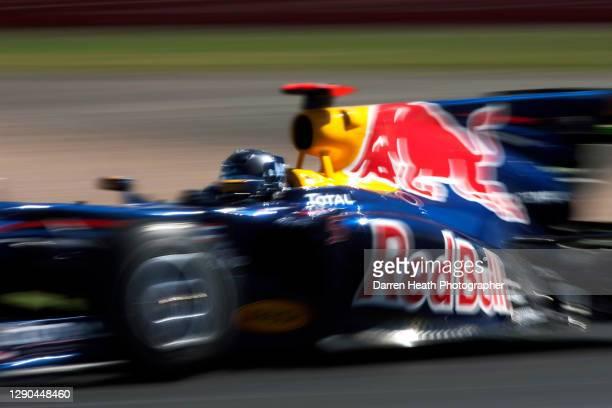 German Red Bull Racing Formula One racing driver Sebastian Vettel driving his Red Bull Racing RB6 racing car during practice for the 2010 British...