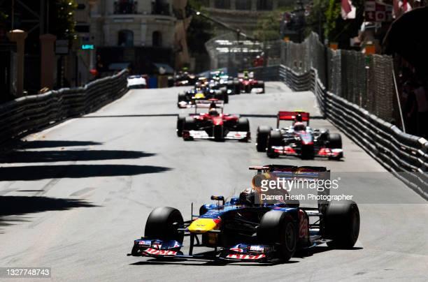 German Red Bull Racing Formula One racing driver Sebastian Vettel driving his RB7 racing car while leading British McLaren driver Jenson Button in...