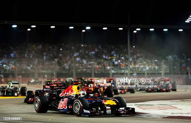 German Red Bull Racing Formula One racing driver Sebastian Vettel driving his RB6 racing car around Turn Three of the circuit just after the start of...