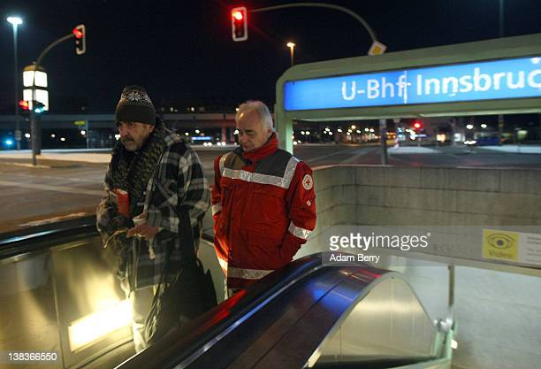German Red Cross volunteer employee Carlo Trobisch walks with a homeless man by the name of Rainer as they head to the Waermebus or Warmth Van to...