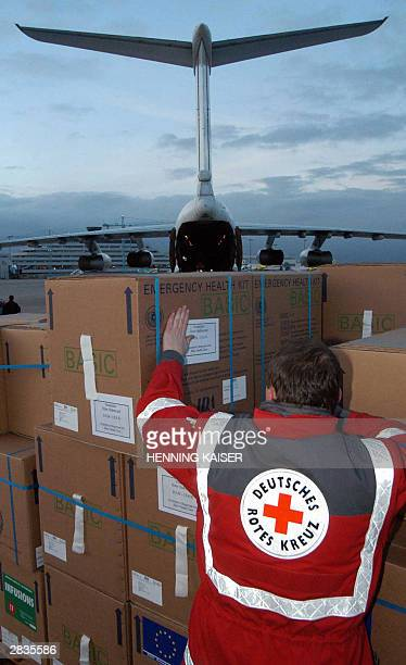 German Red Cross worker prepares a shipment of aide material for the devastated area of Bam in south Iran in Cologne airport 29 December 2003 The DRK...