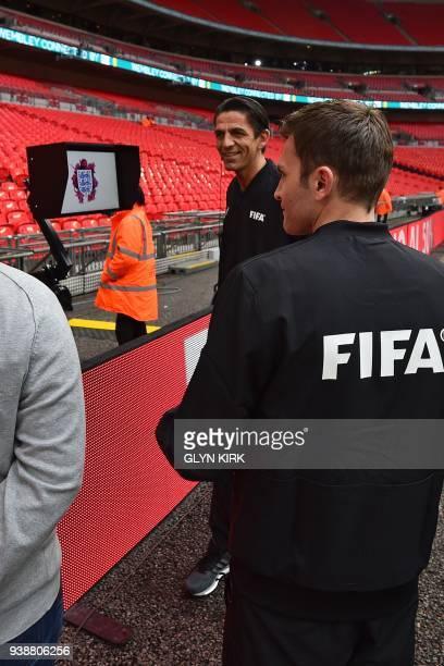 German referee Deniz Aytekin checks out the VAR system ahead of the International friendly football match between England and Italy at Wembley...