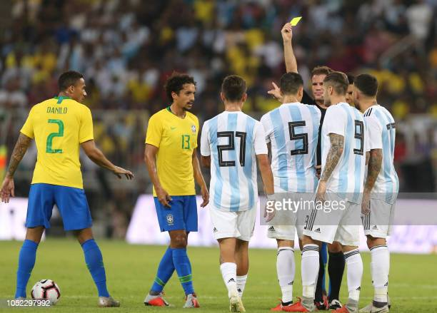 German referee Felix Brych gives a yelloz card to Argentina's midfielder Leandro Paredes during the friendly football match Brazil vs Argentina at...