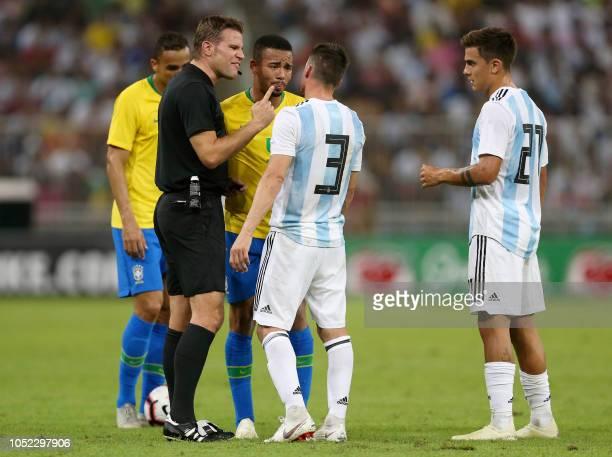 German referee Felix Brych speaks to Brazil's forward Gabriel Jesus Argentina's defender Nicolas Tagliafico and Argentina's forward Paulo Dybala...