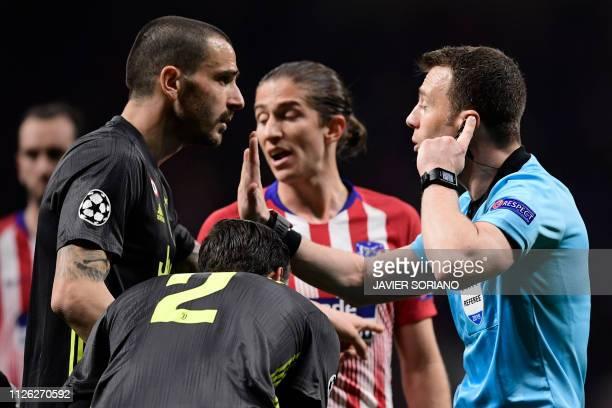 German referee Felix Zwayer gestures to Juventus' Italian defender Leonardo Bonucci during the UEFA Champions League round of 16 first leg football...