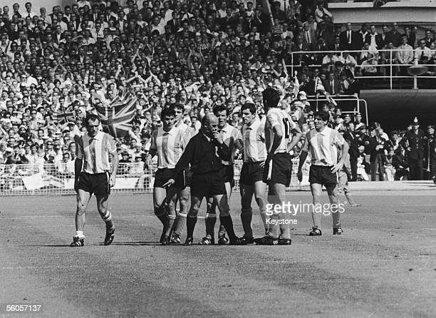 German referee Rudolf Kreitlein sending off the Argentina captain Antonio Rattin during the World Cup match between England and Argentina at Wembley...