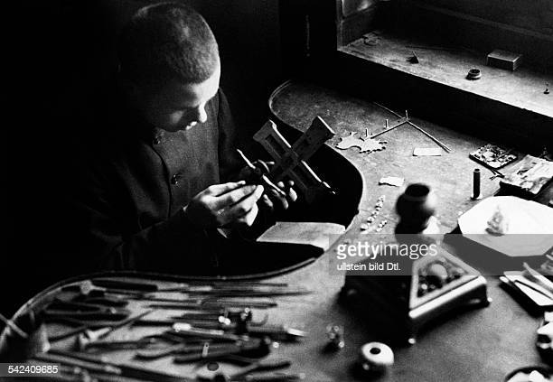 German Reich Beuron Archabbey Benedictine monk in the goldsmith's workshop of the monastery Photographer Felix H Man Dephot Published by 'Berliner...