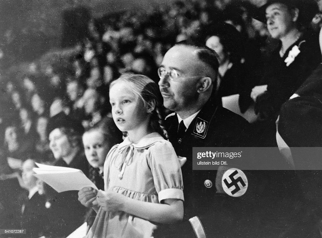 HEINRICH HIMMLER (1900-1945). German Reichsf³hrer-SS and Gestapo chief. Himmler and his daughter at a sports event at Berlin, Germany, March 1938. : News Photo