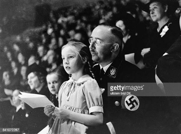 HEINRICH HIMMLER German Reichsf³hrerSS and Gestapo chief Himmler and his daughter at a sports event at Berlin Germany March 1938
