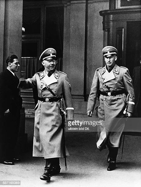 German Reichsf³hrer-SS and Gestapo chief walking out of the Hotel Metropol in Vienna with Reinhard Heydrich, 1938.