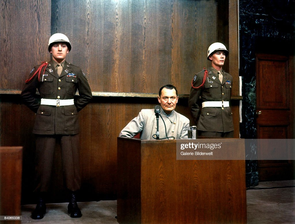 German Reichsmarschall, Commander of the Luftwaffe Hermann Goering (1893 - 1946) during cross examination at his trial for war crimes in Room 600 at the Palace of Justice during the International Military Tribunal (IMT), Nuremberg, Germany, 1946.