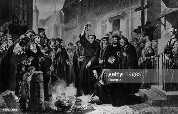1520 German religious reformer Martin Luther burning the papal bull containing 41 theses issued against him before a crowd of doctors students and...