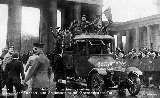 German Revolution in Berlin Germany 1918 Car with machine guns in front of the Brandenburger Tor with council of workers and soldiers In November...