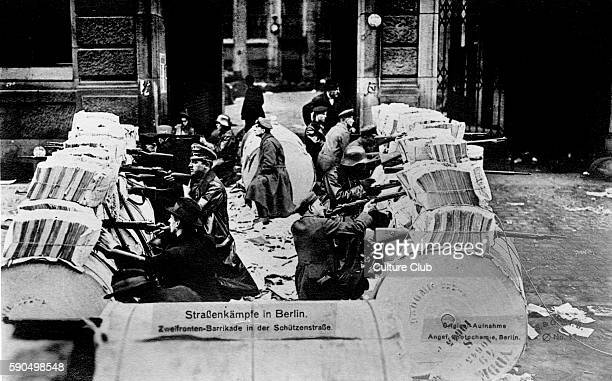 German Revolution in Berlin Germany 1918 Street battles barricades in Schutzen Stra§e In November 1918 Spartacist leader Karl Liebknecht declared the...