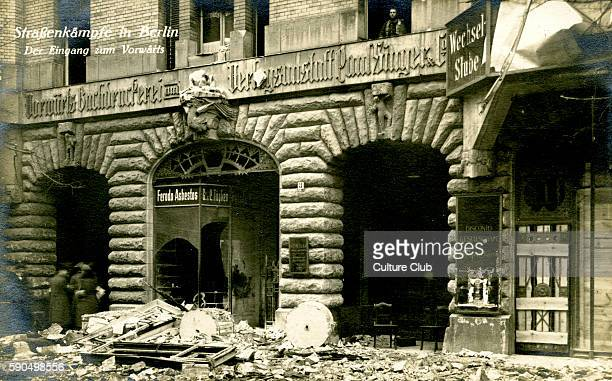 German Revolution in Berlin Germany 1918 Street fighting rubble and damaged shops In November 1918 Spartacist leader Karl Liebknecht declared the...