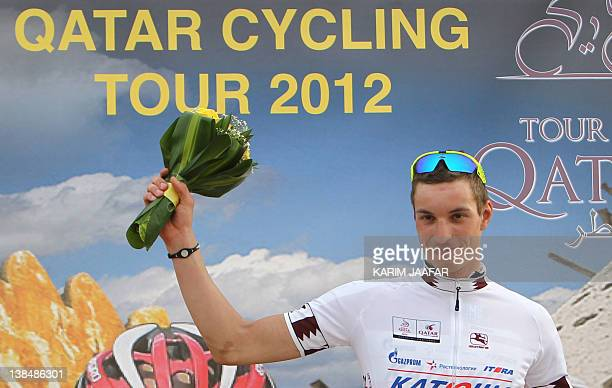 German rider Rudiger Selig of the Katusha Team celebrates on the podium with the best young rider's white jersey at the end of the 146 kilometer...