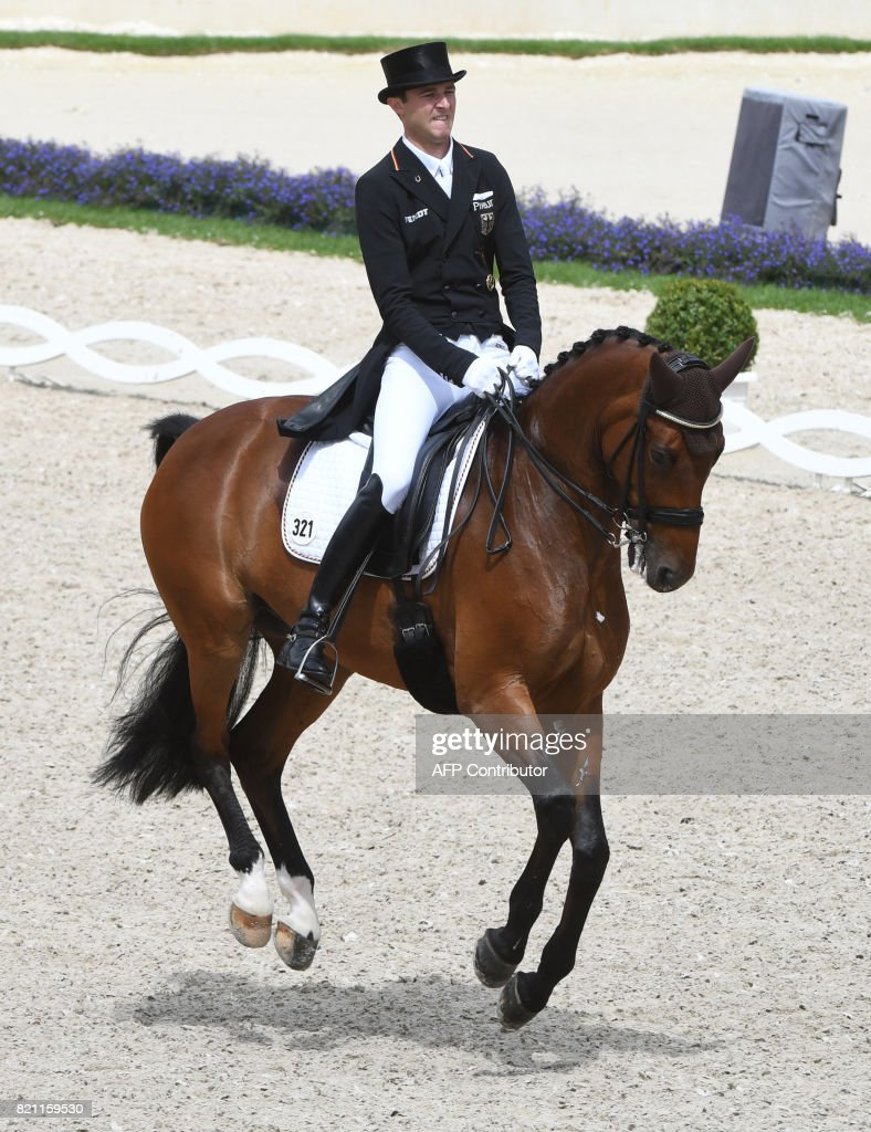German rider Soenke Rothenberger on his horse Cosmo 59 competes in ...