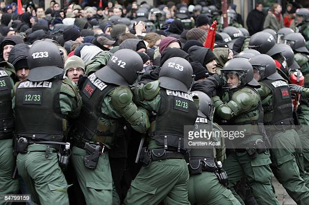German riot police block leftwing protestors during a rally against a farright march on February 14 2009 in Dresden Germany Reportedly over 10000...