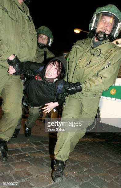 German riot police carry a demonstrator they arrested on suspicion of throwing a bottle at them during the Walpurgis night clashes with riot police...