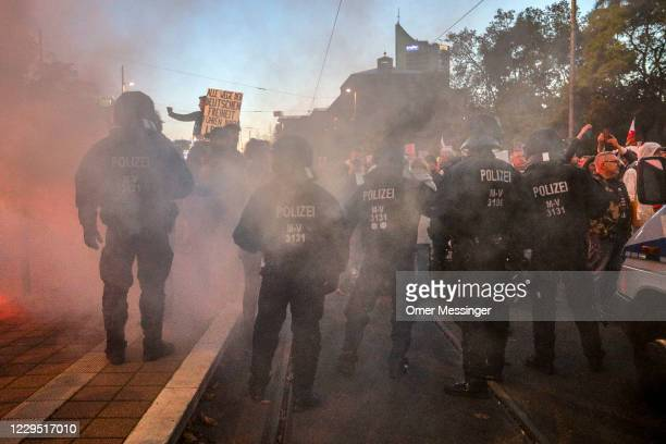 German riot police confront demonstrators as supporters of the Querdenken movement, which opposes coronavirus lockdown measures and has demanded the...