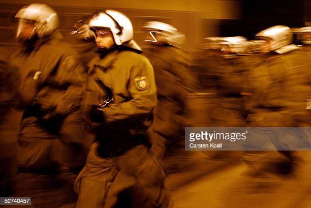 German riot police run to confront demonstrators in the district of Friedrichshain April 30 2005 in Berlin Germany Walpurgis Night or Walpurgisnacht...