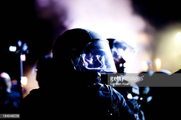 German riot police stand guard as antinuclear activists protest against the transport of nuclear waste on November 24 2011 in Metzingen Germany A...