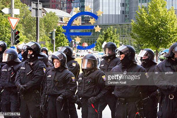 German riot police stand guard during an unauthorized blockade of a road in front of the EZB building during the Blockupy protests on May 18 2012 in...