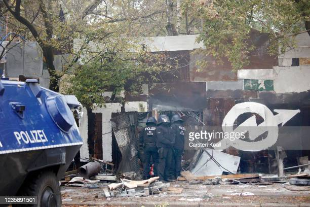 German riot police use technical vehicles to break down the wall of the territory of the left alternative site trailer Camp Kopi on October 15, 2021...