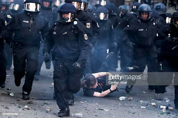 German riot policemen over run a protester after a march on May Day on May 2016 in Berlin Germany Tens of thousands of people across Germany...