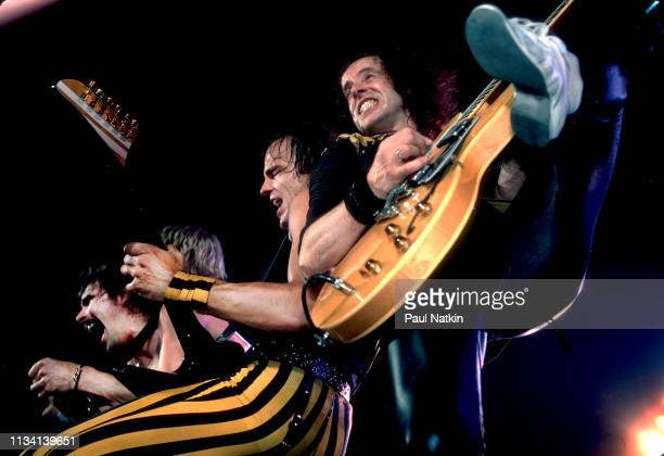 German Rock group Scorpions perform onstage at the Rosemont Horizon Rosemont Illinois May 20 1984 Pictured are from left musicians Rudolf Schenker...
