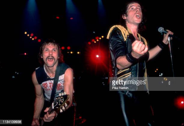German Rock musician Rudolf Schenker on guitar and vocalist Klaus Meine both of the group Scorpions perform onstage at the Rosemont Horizon Rosemont...