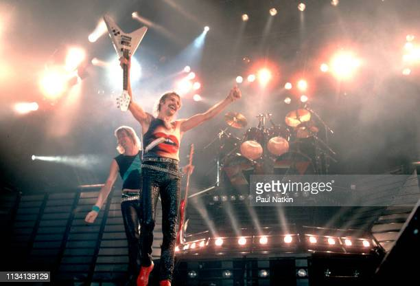 German Rock musicians Francis Buchholz on bass guitar and Rudolf Schenker on guitar both of the group Scorpions perform onstage at the Rosemont...