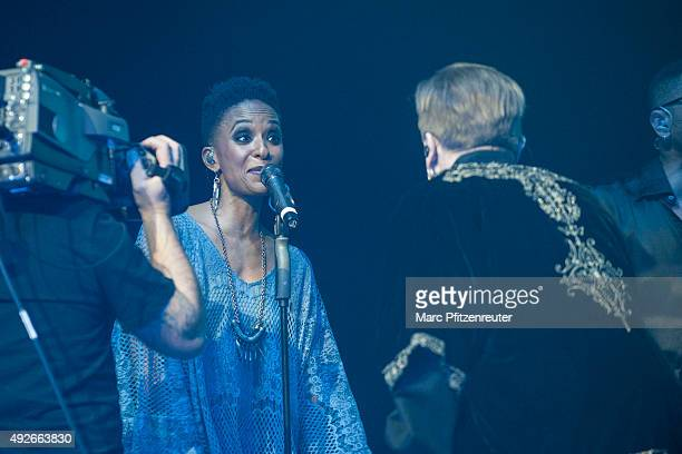 German rock singer Marius Mueller-Westernhagen and background singer Lindiwe Suttle interact onstage at the Lanxess Arena on October 14, 2015 in...