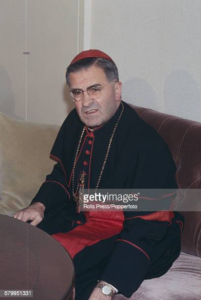 German Roman Catholic Cardinal Julius Dopfner pictured sitting at a table in 1967