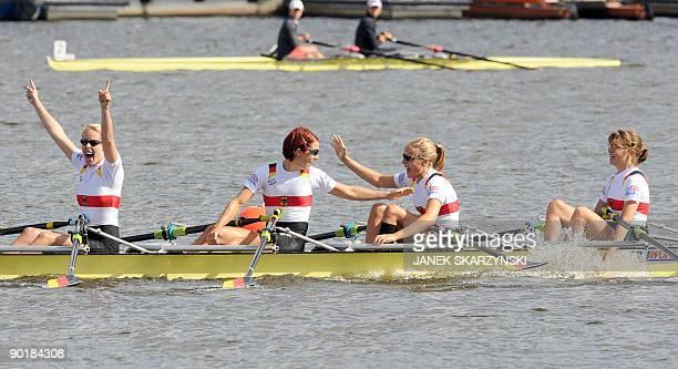 German rowers Julia Kroeger Laura Tibitanzl Helke Nieschlag and Lena Mueller celebrate after the Women's Quadruple Sculls final race during the...