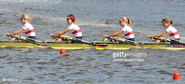 German rowers Julia Kroeger Laura Tibitanzl Helke Nieschlag and Lena Mueller celebrate compete in the Women's Quadruple Sculls final race during the...