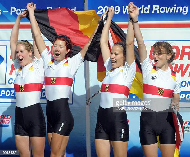 German rowers Julia Kroeger Laura Tibitanzl Helke Nieschlag and Lena Mueller celebrate on the podium after the Women's Quadruple Sculls final race...