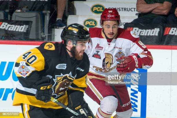 German Rubtsov of AcadieBathurst Titan checks Ryan Moore of Hamilton Bulldogs at Brandt Centre Evraz Place on May 22 2018 in Regina Canada