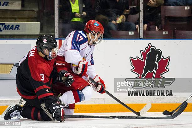 German Rubtsov of Russia battles for the puck against Jake Bean of Canada Black during the World Under17 Hockey Challenge on November 2 2014 at the...
