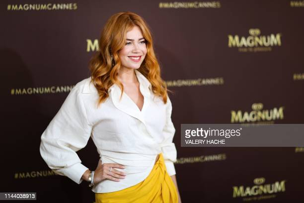 German Russian actress and model Palina Rojinski poses during a photocall at the Magnum Beach on the sidelines of the 72nd edition of the Cannes Film...