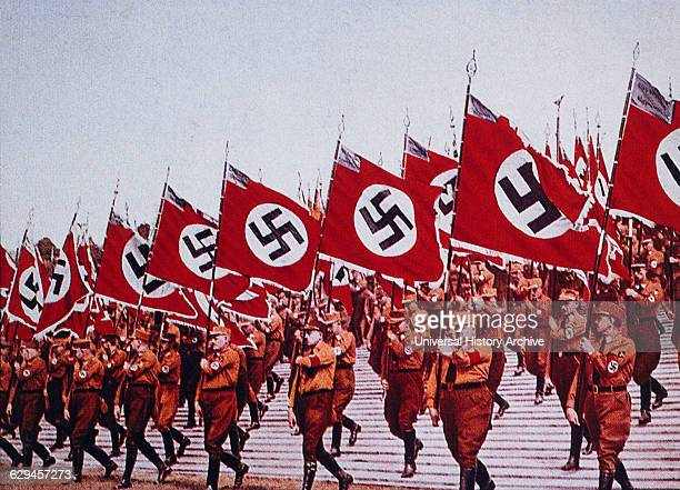 German SA Troops Marching with Nazi Flags at Rally Nuremberg Germany 1933