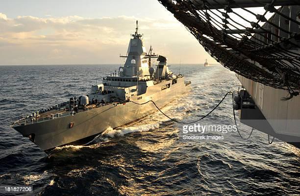 german sachsen-class frigate hessen conducts an underway replenishment. - bundeswehr stock-fotos und bilder