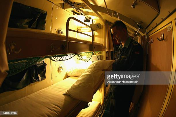 German sailor is shown in sleeping quarters of U 34 the latest addition to the German Navy's submarine fleet is seen in the Marine Harbour of...