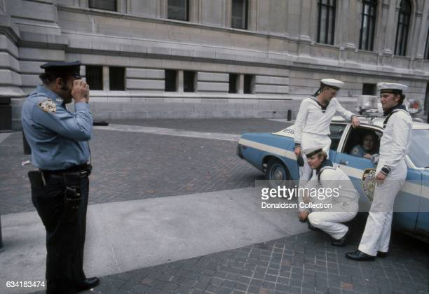 German sailors from the Destroyer Molders pose for a photo taken for them by a NYPD officer outside The Metropolitan Museum of Art located at 5th...