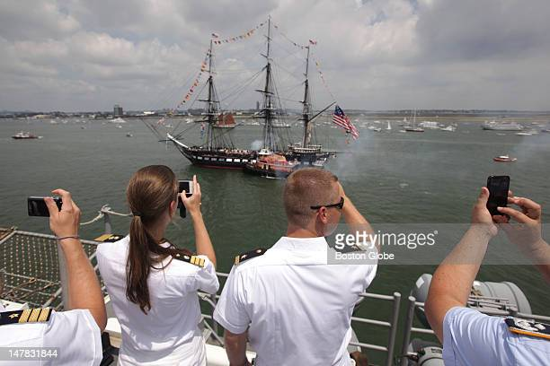 German sailors photograph the USS Constitution during its 19gun salute in front of the USS Wasp on the Fourth of July