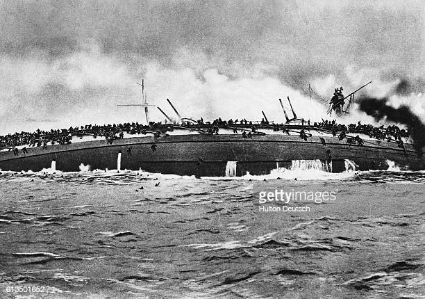 German sailors scramble on to the hull of the Blucher after the bombardment of the ship by the British It was the biggest vessel to fall victim to a...